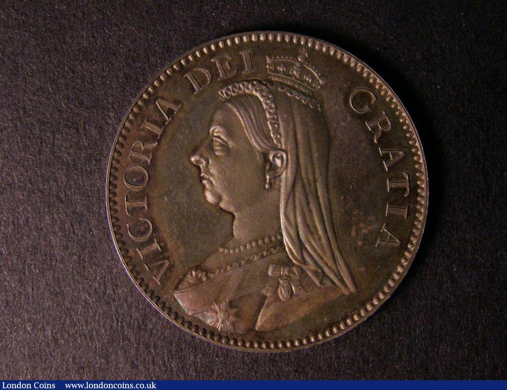 Halfcrown 1884 Pattern ESC 742, Davies 636, struck in silver on a 32mm flan, Obverse: Jubilee style bust with necklace of eleven pearls, larger earring and small crown facing left within wire circle, small letters in legend VICTORIA DEI GRATIA, toothed border, Reverse: Struck en medaille, toothed border, small quartered shield within crowned garter.HONI.SOIT.QUI.MAL.Y.PENSE normal stops, six strings to Irish harp, surrounded by Order of the Garter, date below, number 3 scratched in field next to the date, BRITANNIARUM REGINA FID: DEF plain edge toned mint state, rated R7 by ESC, Ex-Lingford collection, purchased en bloc by Baldwins in 1951, Ex-Colin Adams collection Spink Auction 5033 1/12/2005 lot 717 : English Coins : Auction 122 : Lot 1629