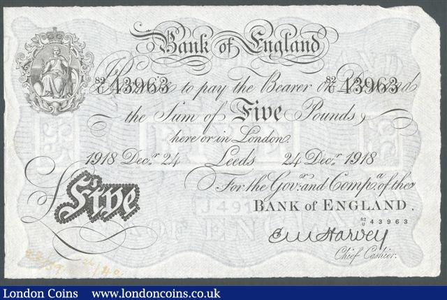 Five pounds Harvey white B209a dated 24th December 1918, prefix 82/U, LEEDS branch issue, paper split & faded inked numbers at bottom, pressed EF, looks better : English Banknotes : Auction 125 : Lot 212