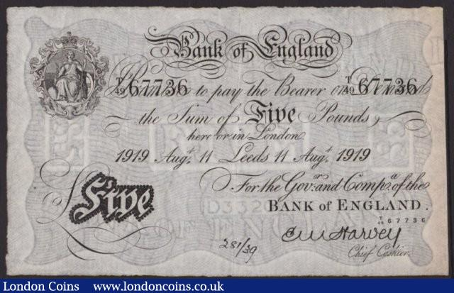 Five pounds Harvey white B209a dated 11 August 1919 serial T/49 67736, LEEDS branch issue, inked number at bottom, about VF : English Banknotes : Auction 137 : Lot 169