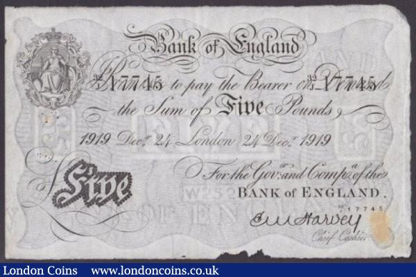 Five pounds Harvey white B209a dated 24th December 1919 series 32/J 17745, stain, pinholes & damage bottom edge, VF : English Banknotes : Auction 140 : Lot 133