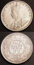 London Coins : A145 : Lot 658 : India Half Rupees (2) 1924 Bombay KM#522 UNC, 1934 Calcutta KM#522 Toned UNC