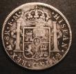 London Coins : A147 : Lot 2233 : Dollar George III Oval Countermark on a Mexico City 8 Reales 1797 FM Mo ESC 129 Countermark VF host ...