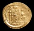 London Coins : A150 : Lot 1695 : Solidus Au. Justinian I. C, 527-565 AD. Obv;  Helmeted and cuirassed bust facing, holding globus cru...