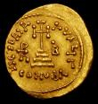 London Coins : A157 : Lot 1754 : Heraclius.  Au solidus.  C, 638-639 AD.  Constantinople.  Obv; Crowned figures of Heraclius, in cent...