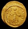 London Coins : A157 : Lot 1808 : Phocas.  Au solidus.  C, 609-610 AD.  Rev;  VICTORIA AVGЧ I; Angel standing facing, holding globus ...