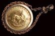 London Coins : A158 : Lot 1310 : South Africa One Tenth Krugerrand 1982 KM#105 EF in a 9 carat mount with thin chain, this broken, to...