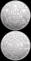 London Coins : A160 : Lot 3371 : Morocco Rial (10 Dirhams) (2) AH1299 (1881) Paris Mint Y#8 GVF, AH1331 (1912) Y#33 EF and lustrous