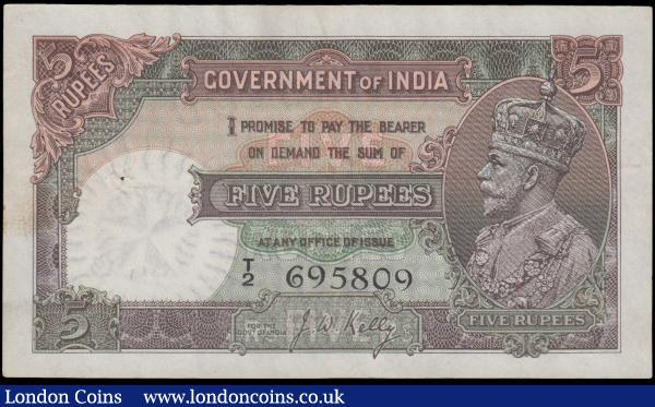 India Government 5 Rupees issued 1928 - 1935 series T/2 695809, King George V portrait to right, signed J.W. Kelly, (Pick15b), pinholes to the left, pressed good VF : World Banknotes : Auction 162 : Lot 267