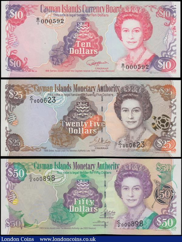 Cayman Islands Monetary Authority (3), 50 Dollars dated 2003 series C/2 000898, (Pick32b), 25 Dollars dated 1998 series C/1 000623, (Pick24), 10 Dollars dated 1991 series B/1 000592, (Pick13a), nice selection of LOW serial numbers, Uncirculated : World Banknotes : Auction 163 : Lot 1412