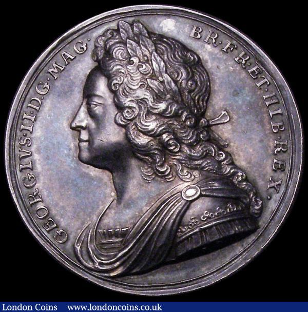Coronation of George II 1727 34mm diameter in silver by J.Croker Eimer 510 the official coronation issue Obverse Bust left Laureate, armoured and draped, GEORGIVS. II. D.G. MAG. BR. FR. ET. HIB. REX. Reverse the King enthroned right, is crowned by Britannia VOLENTES. PER. POPULOS Exergue: CORON. XI. OCTOB. MDCCXXVII GEF or better with old grey and blue toning : Medals : Auction 163 : Lot 52