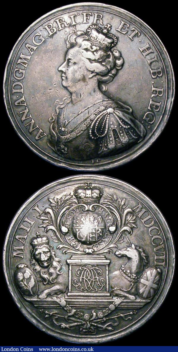 Act of Union 1707 47mm diameter in silver by J.Croker, Eimer 424 Obverse: Bust left crowned and draped, ANNA. D:G: MAG: BR: FR: ET. HIB: REG: Reverse: British shield within the Garter, crowned, upon a pedestal inscribed with the double cypher of A R supported by a lion and a unicorn, MAII I.MDCCVII Good Fine, Battle of Ramillies 1706 34mm diameter in silver by J.Croker, Obverse: ANNA. D:G: MAG: BR: FRA: ET. HIB: REG. Reverse: Map of the conquered provinces, displayed by two Fames, a town in the distance, GALLIS .AD. RAMELLIES. VICTIS. XII. MAII. MDCCVI, in exergue: FLANDR: ET. BRABANT:RECEPT: Good Fine : Medals : Auction 164 : Lot 644