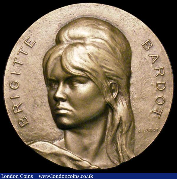 Brigitte Bardot 41mm diameter in bronze undated (1967) Obverse Three-quarters facing portrait of Brigitte Bardot, Reverse Silhouette of the actress with the Titles of many of her films UNC in green case : Medals : Auction 164 : Lot 651