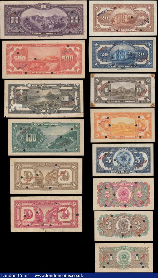 Brazil a complete series SPECIMEN set (13) comprising 1 Mil Reis Pick 110Bs Estampa 1A serie 1A punchole cancelled MODELLO overprint at lower left and right. 2 Mil Reis Pick 111s Estampa 1A serie 1A punchole cancelled MODELLO overprint at lower centre left. 5 Mil Reis (2) Pick 112s Estampa 1A serie 1A and Pick 113a Estampa 2a serie 1a, both with red MODELLO overprint at lower centre and punchole cancelled. 10 Mil Reis (2) Pick 114s Estampa 1A serie 1A and Pick 115s Estampa 2A serie 1A, both with red MODELLO overprint at lower left and right and punchole cancelled. 20 Mil Reis (2) Pick 116s Estampa 1A serie 1A and Pick 117s Estampa 2A serie 1A, both with MODELO overprint in red on P116s and in blue on P117s and punchole cancelled. 50 Mil Reins (2) Pick 118s Estampa 1A serie 1A and Pick 119s Estampa 2A serie 2A, both with red overprint MODELLO at lower centre right and centre left and punchole cancelled. 100 Mil Reis Pick 121s Estampa 1A serie 1A red Modello overprint at lower left and right and punchole cancelled. 200 Mil Reis Pick 121s Estampa 1A serie 1A red MODELLO overprint at lower centre slightly scuffed and punchole cancelled. 500 Mil Reis Pick 122A Estampa 1A serie 1A blue MODELLO overprint at lower centre left and right and punchole cancelled. 1000 Mil Reis Pick 123s Estampa 1A serie 3A red MODELLo overprint at lower left and right and punchole cancelled. Average VF - EF and Exceptionally Scarce FULL series SPECIMEN set seldom offered on the market  : World Banknotes : Auction 165 : Lot 1178