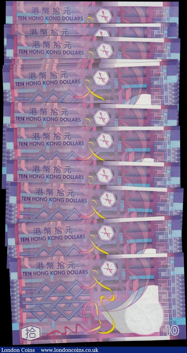 Hong Kong $10 (12) dated 2002, a consecutive numbered run, scarcer replacement series ZY, Pick400r UNC. Along with regular issue series CL303342 and Replacement series ZZ487851 both about UNC - UNC. Government of Hong Kong Special Administrative Region and the notes in purple, blue and multicolour featuring geometric patterns : World Banknotes : Auction 165 : Lot 612