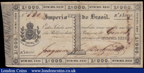 Brazil Imperio Do Brazil 1 Mil Reis Exceptionally Rare Copper Exchange note Pick A151a 1 signature variety 03.10.1833 No. 620 Arms at left Ceara Province VF - GVF small original paper repair on reverse. The note with very small ink burns due to the tanic acid used in the early inks. Printed in Rio de Janeiro these notes were issued throughout all provinces and were used in exchange for debased copper coinage, the names of the individual provinces were handwritten on each piece issued : World Banknotes : Auction 166 : Lot 147