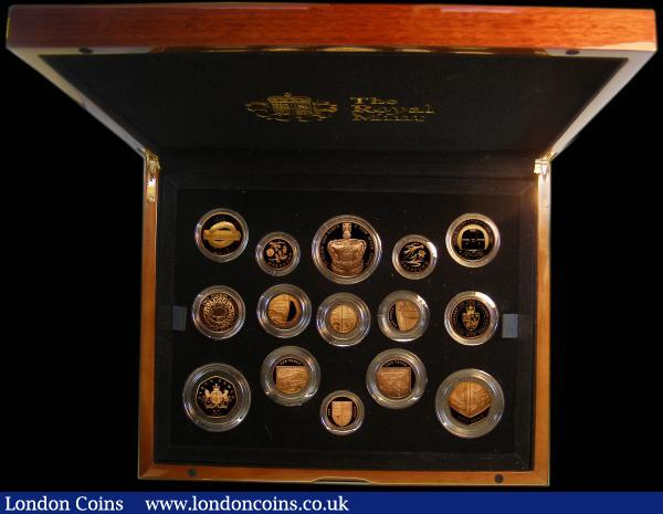 The 2013 United Kingdom Gold Proof Set an eye-catching 15-coin set comprising Five Pound Crown 2013 60th Anniversary of the Coronation, Two Pounds (4) 2013 Technology, 2013 London Underground Sign, 2013 London Underground Train, 2013 200th Anniversary of the First Gold Guinea, One Pound 2013 England - Floral, 2013 Wales - Floral, Fifty Pence 2013 Christopher Ironside, and the Royal Shield of Arms set 2013 One Pound to One Penny all struck in 22 carat gold, S.PGCAS, a magnificent set nFDC to FDC with a hint of toning, in the large Royal Mint box of issue with certificate, the definitive coins have a mintage of only 60 pieces each, as has the set : English Cased : Auction 166 : Lot 810