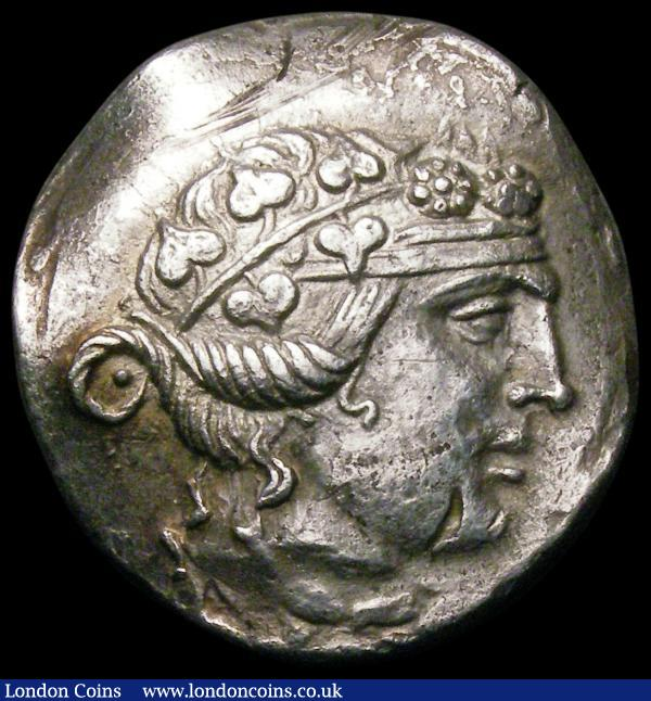 Ancient Greece -Thasos, Thrace Silver Tetradrachm. (After 148BC)  Obverse Head of Dionysus right, wreathed with ivy/ Reverse: HPAKΛEOYΣ ΣΩTH POΣ ΘAΣIΩN, Herakles standing left with club and lion's skin, M to left, BMC 72, 16.23 grammes, VF or better on a dished flan : Ancient Coins : Auction 167 : Lot 330
