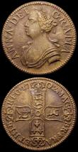 London Coins : A168 : Lot 1022 : Jettons (2) 1702 Queen Anne, reverse four shields in cruciform 23.5mm diameter in brass? GVF, 1761 Q...
