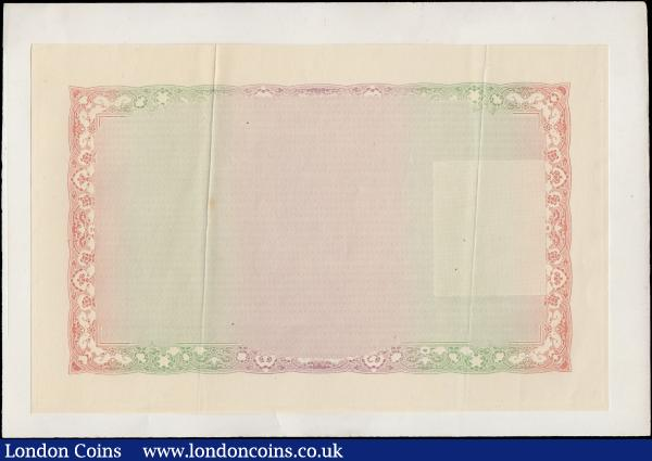 Bradbury Wilkinson reverse unfinished trial proof, circa 1907, Asian or Middle Eastern design (Bank and country need verifying), rectangular pale pink, green and multi-coloured, stuck to thin paper from a book page.  : World Banknotes : Auction 169 : Lot 124