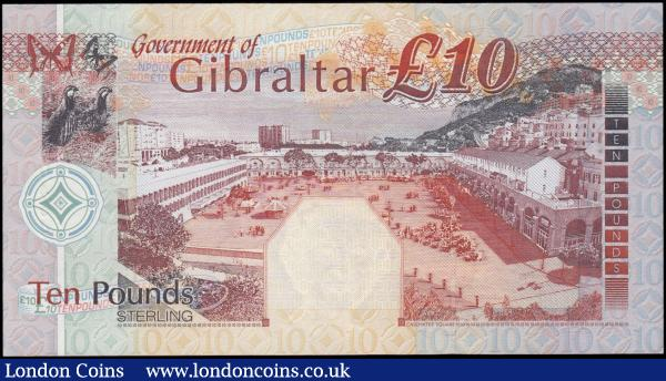 Gibraltar 10 Pounds Pick 30 dated 10th September 2002 serial number B 004640, choice and crisp UNC and with much eye appeal in this high grade. Orange-brown and violet on multicolour featuring the Coat of Arms, cannon, lighthouse and Queen Elizabeth II at right and as watermark. The reverse illustrating grouse birds and butterflies at upper left and a Casemates Square scene. : World Banknotes : Auction 169 : Lot 181