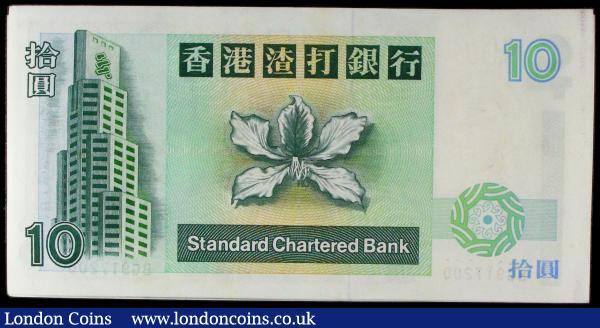 Hong Kong Standard Chartered Bank 10 Dollars Pick 284a dated 1st January 1993 (100) a consecutive set in an original bank wrapper serial numbers BG917101 through BG917200. The notes in dark green on yellow green underprint featuring a mythological carp at right on obverse and the Bank building at left and Bauhinia flower blossom at centre on reverse. Watermarked with an SCB inscription over a helmeted warrior head. All UNC with very Minor wear only on the utmost top and bottom note mentioned for accuracy : World Banknotes : Auction 169 : Lot 194