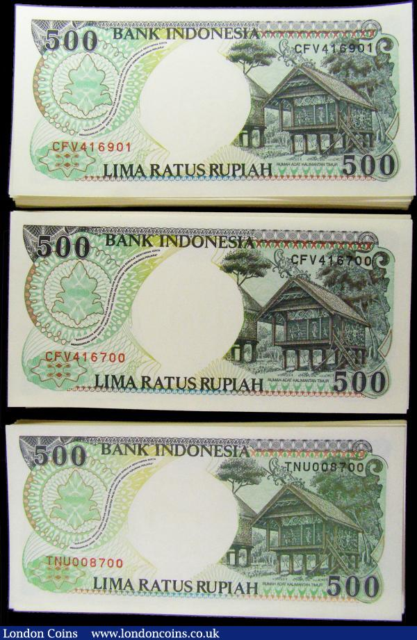 Indonesia Bank 500 Rupiahs 1992 -1999 (300) in 3 consecutively numbered bundles of 100 notes each. The first bundle Pick 128b 1992/1993 serial numbers TNU008601 through TNU008700. The second and third bundle Pick 128g 1992 / 1998 - serial numbers CFV416601 through CFV416700 and CFV416901 through CFV 417000 including a RADAR number CFV416614 . The notes in brown and green on multi-coloured underprint featuring an Orangutan resting on a tree branch at left and Coat of Arms at upper right on obverse and the reverse showing an illustration of native huts at E. Kalimantan Eastern Borneo at right on reverse. All printed by Perum. Percetakan Uang and watermarked with a portrait of the Indonesian nationalist H. O. S. Cokroaminoto who was one of the leaders of the Islamic Trade Union which then he co-founded the Sarekat Islam. All notes crisp UNC : World Banknotes : Auction 169 : Lot 198