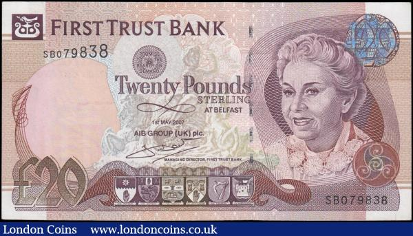 Ireland (Northern) First Trust Bank 20 Pounds Pick 137b (BY NI.422b, PMI FT10) dated 1st May 2007 serial number SB 079838 signature T. McDade, EF or better. Mauve and brown on multicolour featuring a mature lady portrait at right, statue of a boy with horses in the underprint and six Coat of Arms of the six counties of Northern Ireland at lower centre. The reverse illustrating the 'rock chimney' at Lacada Point, Giant's Causeway. Printed by De La Rue and watermarked with a young woman. : World Banknotes : Auction 169 : Lot 206
