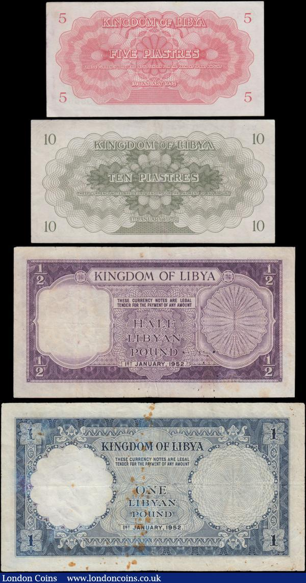 Libya Kingdom part denomination set of the 1st January 1952 'King Idris' issues (4) all in good Fine to GVF-EF comprising the 5 Piastres Pick 12 series K/4 099561, red. 10 Piastres Pick 13 series H/2 010338, green. 1/2 Libyan Pound Pick 15 series D/2 941400, purple on multi-coloured underprint. And together with 1 Libyan Pound Pick 16 series C/3 883462, blue on multi-coloured underprint, some Rust spots. All Scarce and collectable examples : World Banknotes : Auction 169 : Lot 230