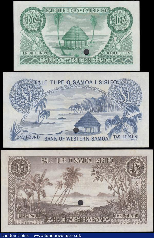 Western Samoa Pound / Pauni System ND (1963) SPECIMEN set (3) comprising 10 Shillings Pick 13s dark green on multicolour arms at left on obverses and thatched hut at centre on reverse, 1 Pound Pick 14s this with minor foxing, dark blue on multicolour underprint Palms and rising sun at left and right, Arms at centre on obverse and thatched hut and lagoon on reverse and 5 Pounds Pick 15s this with minor foxing and marginal stain, brown on multicolour underprint Kava bowl at left and red and blue flag over Arms at right on obverse and shoreline with palm trees, sea and islands scene on reverse. All with diagonal red overprint SPECIMEN on obverse and punchole cancelled through signature, all about UNC to UNC : World Banknotes : Auction 169 : Lot 288