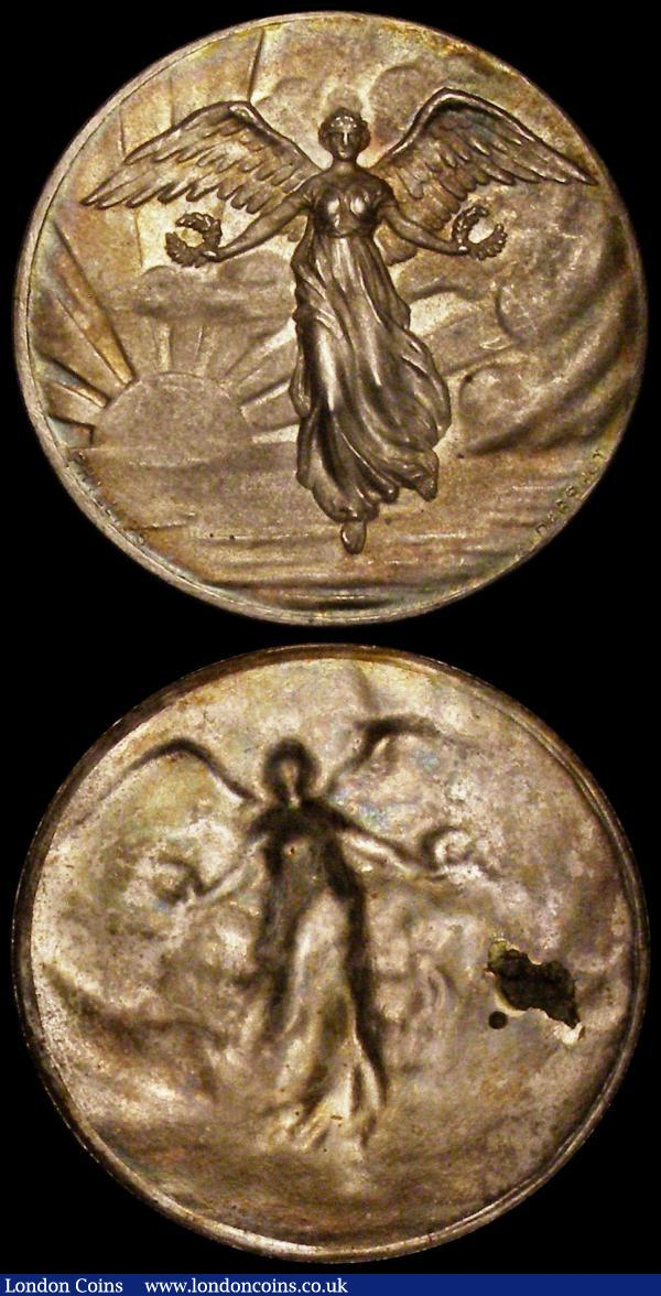 Cliché medals (2) the first undated by Phillips Aldershot of London, uniface and 32mm diameter Obverse: Angel holding two laurel wreaths facing, with sun and seascape behind, the second 32mm diameter undated and uniface depicting a standing woman above a kneeling man crowning him with a laurel wreath, loosely based on the  style of 'Art is Obtained Through Labour' by Nicolas Reyers (c.1780) both EF with light gold tone : Medals : Auction 169 : Lot 333