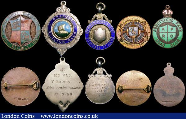 Prize Medals and Badges (10) Prize Medals (5) Sparkbrook & District Football League Prize Medals (2)  1932-33 Birmingham Cup Finalist in silver with blue enamel, Division 2 Runners-up 1933-34 with WLM makers mark in silver with blue enamel, Cycling Prize Medals (3) London - Woolwich 1949 in silver with light and dark blue enamel, 1st prize presented to E.Gagen Bromley R.C, Hampshire - Gosport Cycling club First prize presented to T.Dougal, Manchester Abbotsford Park Road Club undated, in bronze with green enamel. Badges (5) Gordon Smith Institute of Seamen, Nation Union of Railwaymen, The Edward Shelley Central School, Walsall, W.M.B.A enamelled badge with daffodil, The League of Ovaltineys in mixed condition : Misc Items : Auction 169 : Lot 385