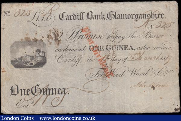 Cardiff Bank, Glamorganshire 1 Guinea dated 11th March 1819 No. R325 For Wood, Wood & Co. manuscript signed John Wood and Entered with initials that best judged appear to be N.J. or N.T. (Outing 418c), a pleasing and quite presentable VF with few minor pinholes and a minor inner split to left centre body expected for the notes age, however a very well kept example and an Exceptionally Rare denomination. In fact, from research over the internet there seem to be none offered in recent times and the only example that appears is currently displayed in the British Museum Collection in what appears from the pictures to be an inferior grade to this example. Uniface in black & white printed by engraver and printer Henry Mutlow, with imprint Mutlow fc. Ridflow Co. London and displaying a Cardiff Castle vignette to centre left. Henry Mutlow, engraver to the King, was born around 1756 and mostly engraved maps and banknotes beginning his career with an apprenticeship to William Darling. The note displays very clear characteristics as an embossed Revenue Stamp for 5 Pence, a red diagonal First Dividend stamp on face and a bankruptcy exhibition stamp dated Oct 22nd 1823 on reverse with a manuscript inked signature along with an inked numeral to right. A unique chance for any British Provincial banknote collector to acquire this fabulous example : English Banknotes : Auction 170 : Lot 105