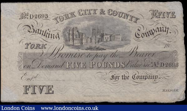 York City & County Banking Company 5 Pounds Unissued Remainder circa 1830-80's No. D2693 (Outing 2456d) printed by Perkins & Bacon, London Patented Hardened Steel plates, a pleasing GVF - EF for type with some foxing and the note out of a frame with visible mounting points on the corners but not glued or similar, the frame had small plastic insert points for each corner of the note to be inserted in which protected the paper from foxing up at these spots. Being Rare and in high grade makes this note a fabulous example of the early provincial issues : English Banknotes : Auction 170 : Lot 115