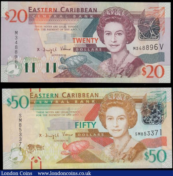 Eastern Caribbean (2) a high grade QE2 portrait pair, UNC or near so, consisting of a 20 Dollars Pick 44v ND 2003 serial number M 348896 V suffix V for St. Vincent, Governor House, map of the isles and Nutmeg plant. Along with a 50 Dollars Pick 54a ND 2012 narrow segmented security thread variety with red marks for the sight impaired, St Kitts, Brimstone hill, map of the isles and St Lucia, Les Pittons. Both bear the signature of  K.D. Venner along with a silver foil Butterfly/Hummingbird security device and Bank building in the underprint without the extension on obverse, also featuring various sea and bird life.  : World Banknotes : Auction 170 : Lot 153