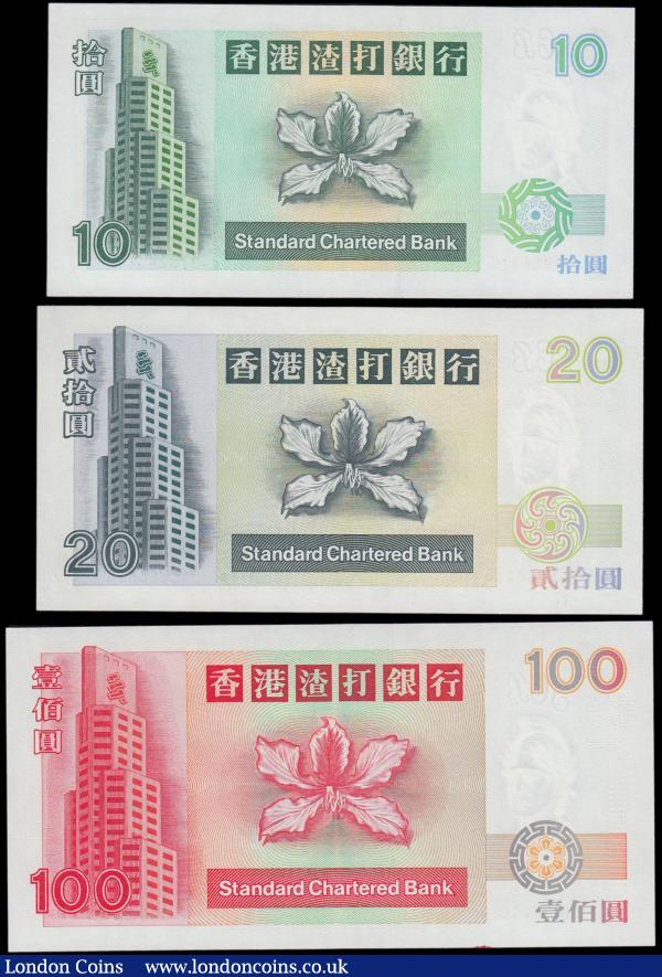 "Hong Kong Standard Chartered Bank (3) examples of the Mythical Animals & Blossom issues all dated 1st January 1994 and UNC comprising 10 Dollars Pick 284b (MARS S17) serial number BT 924816, mythical fish. 20 Dollars Pick 285b (MARS S18a) serial number C 666604, Mythical tortoise Bixi (6th son of the dragon). Along with the 100 Dollars Pick 287b (MARS S37) serial number AH 483464, Mythical horse ""Quilon"". All pleasing notes and watermarked with the Bank's monogram above the well-recognized and used by the bank through the years helmeted warrior : World Banknotes : Auction 170 : Lot 173"