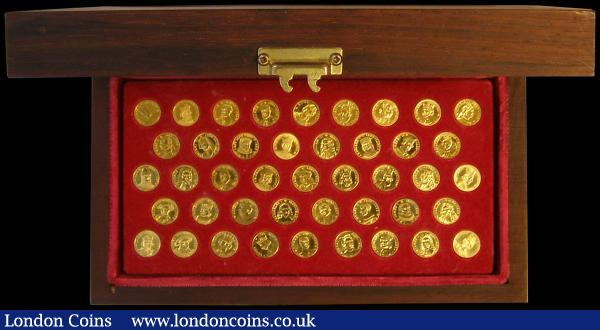 Kings and Queens of England a rare 43 miniature medal set in 22 carat gold, each piece depicting a monarch's portrait with shield in garter reverse and each piece individually hallmarked as 22 carat gold on the rim and weighing 3.12 grams, Unc and displayed in a presentation box (contains 3.95 ounces of pure gold) : Medals : Auction 170 : Lot 377