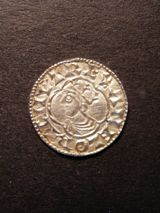 London Coins : A125 : Lot 748 : Penny Cnut, quatrefoil type, moneyer Aelfri on London. S.1157. Very fine