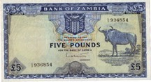 London Coins : A126 : Lot 386 : Zambia £5 issued 1964, prefix C/2, wildebeest at right, Pick3a, pressed, a...
