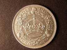 London Coins : A124 : Lot 191 : Crown 1928 ESC 368 A/UNC slight metal fault on the King's hair