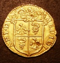 London Coins : A133 : Lot 1403 : Italy Milan Gold Doppia 1589 Philip II Friedberg 716 GVF/NEF boldly struck with a flan flaw on the r...