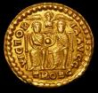 London Coins : A157 : Lot 1751 : Gratian.  Au solidus.  C, 374-375 AD.  Trier.  Ev; VICTORIA AVGG; two emperors seated facing, jointl...