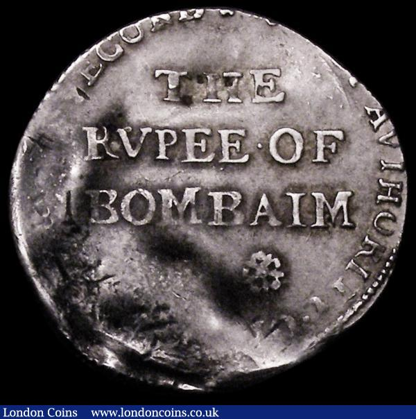 India - Bombay Presidency Pattern Rupee 1678 KM#Pn2, Pridmore 20, struck in silver at the Tower Mint, Obverse: THE RVPEE OF BOMBAIM in three lines, with two roses below, [BY] AUTHORITY OF [CHARLES THE] SECOND, Reverse: Crowned British Shield [KINGE. OF. GREAT. BRITAINE. ] FRANCE . AND. IREL [AND] 5.76 grammes, Fine on a wavy flan, struck off-centre, Very Rare. We refer to Pridmore Auction October 1982, Lots 450 and  451, this example with more similar striking and flan positioning to Lot 451, we also note a silver example in the British Museum  with larger roses, and weighing 10.83 grammes, only a handful of examples known in silver, we also note examples are known struck in pewter, a pewter example selling at Baldwins in 2009 for £10,552 inclusive of buyers premium : World Coins : Auction 162 : Lot 1211