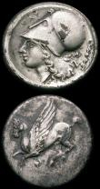London Coins : A165 : Lot 1984 : Ancient Greece (2) - Ar Stater Akarnania c.350-300BC Obverse: Athena helmeted, left,  NAV monogram b...