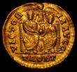 London Coins : A165 : Lot 1992 : Gold Solidus Gratian Mid 373-April 375AD, Obverse: DN GRATIANVS PF AVG, pearl diademed, draped and c...