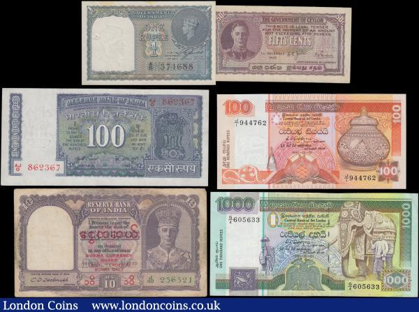 "Asia South & Southeast 1940's to modern (6) including some George VI issues and all different and interesting notes in mixed grades VF to UNC some with the usual Pinholes. Comprised of Burma British Colonial 10 Rupees Pick 32a George VI facing portrait ND 1947 overprint ""Burma Currency Board"" signature Deshmukh green serial J/49 256521. India (2) including 1 Rupee George VI Pick 25a 1940 black serial number A/5 374688 and without Plate letter along with 100 Rupees Pick 64b ND signature K. R. Puri (1975-1977) correct Urdu spelling of last word on reverse and without plate letter series AJ/O 862367. Ceylon 50 Cents George VI portrait Pick 45b dated 1st December 1949 serial number A/48 730865. And Sri Lanka examples of the Heritage series 1st January 1991 (2) consisting of 100 Rupees Pick 105b dated 1st January 1991 series J/I 944762 and Corrected version with dot above Tamil letter left on front. Along with a 1000 Rupees Pick 107a dated 1st January 1991 series G/4 605633. : World Banknotes : Auction 171 : Lot 80"