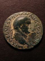 London Coins : A125 : Lot 710 : Vespasian copper As, R. JUDAEA CAPTA, Judea as mourning captive seated right by palm tree am...